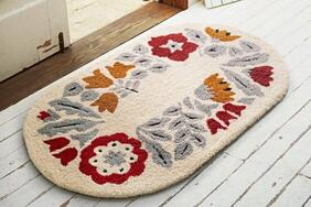 玄関マット「NICE/ニース」はオレンジとレッド色の花柄パターン